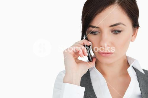 Upset blue eyed businesswoman on the phone