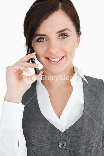 Blue eyed brunette in suit on the phone