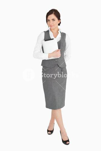 Beautiful businesswoman holding an ebook reader