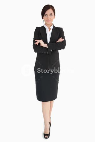 Woman in black suit with folded arms