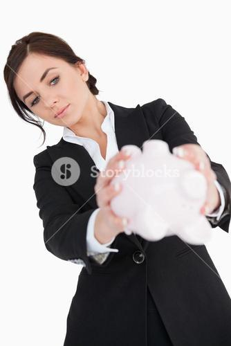 Woman in black suit emptying a piggy bank