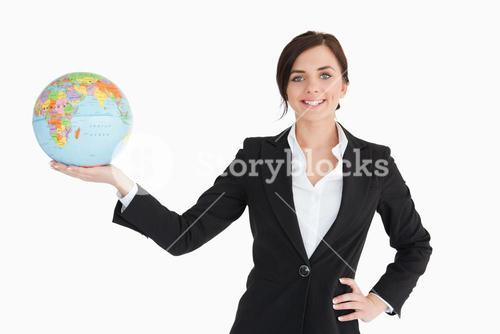 Smiling businesswoman holding an earth globe in her palm