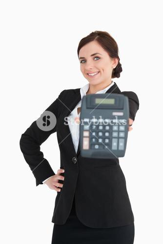 Smiling businesswoman in black suit showing a calculator
