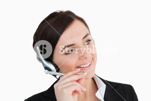 Businesswoman in black suit using a headset