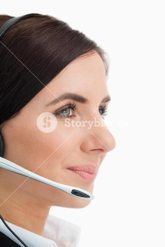 Green eyed woman wearing a headset