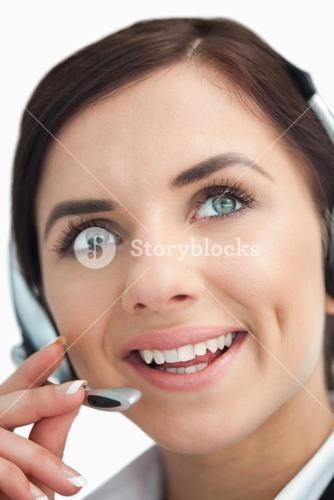 Blue eyed businesswoman with headset looking up