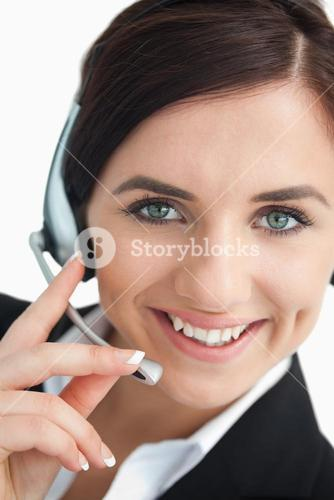 Smiling green eyed businesswoman with headset