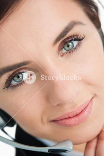 Blue eyed woman with headset