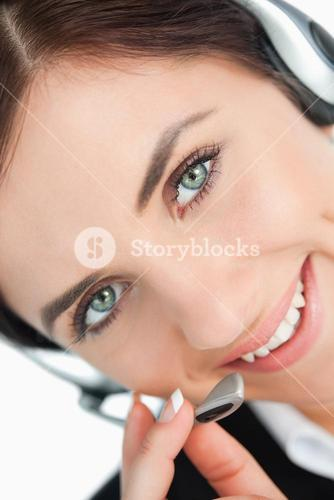 Green eyed woman with headset