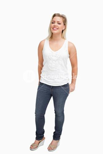 Woman standing upright with her hands in her pockets