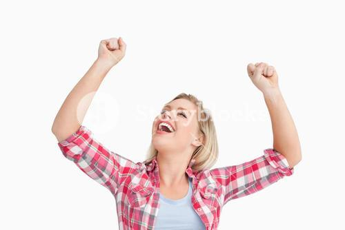 Happy woman raising her two fists