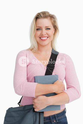 Happy blonde woman holding a school book