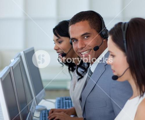 Smiling businessman in a call canter
