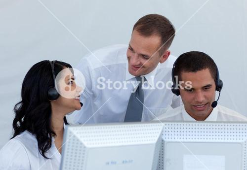 Manager and business people talking in a call canter