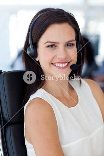Portrait of a smiling businesswoman in a call centre