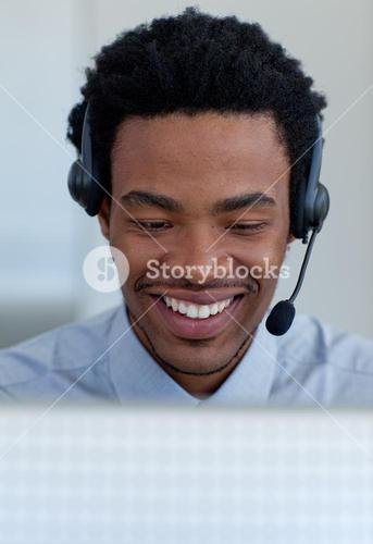 Smiling businessman talking in a call center