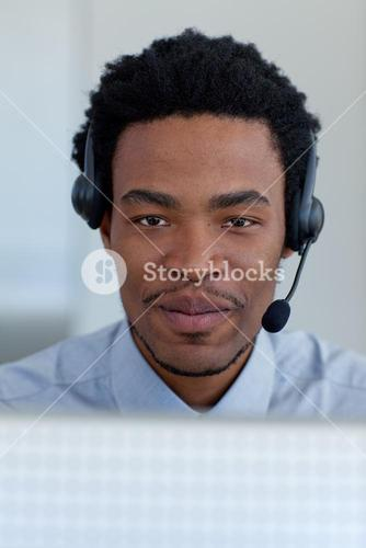 Portrait of businessman in a call center