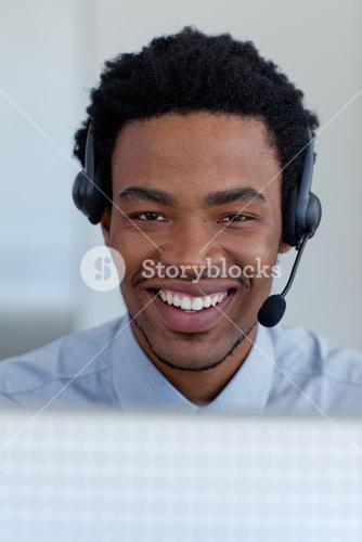 Portrait of a smiling businessman in a call center