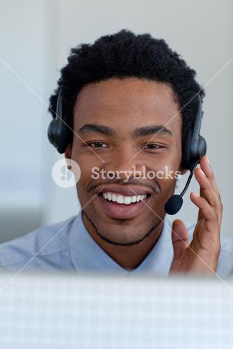 Young businessman in a call center