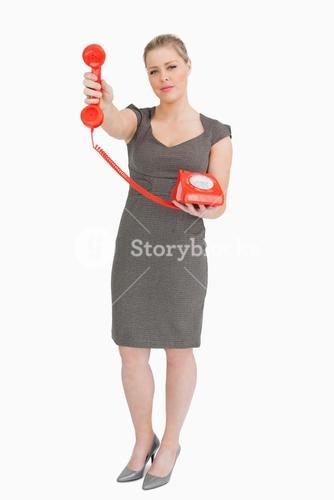 Woman holding a red phone