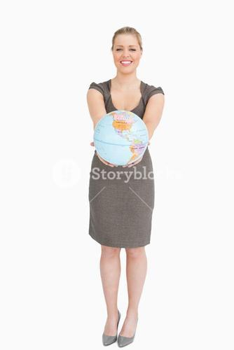 Woman smiling showing a globe
