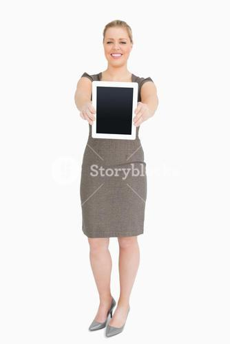 Woman standing showing an ebook screen