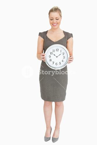 Woman showing a clock