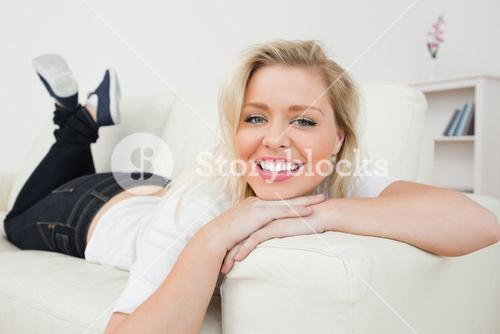 Woman smiling while lying down