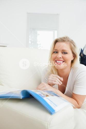 Casual woman reading while she is lying