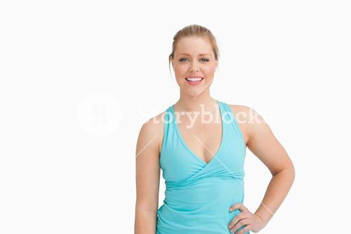 Woman with a blue tshirt with a hand on her hip