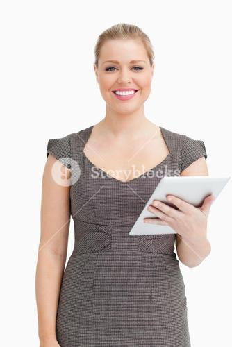 Woman smiling while using an ebook
