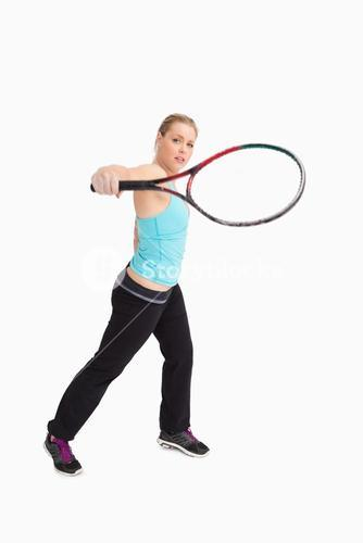 Woman playing tennis with a racket