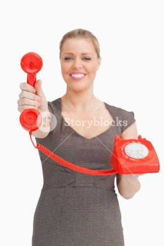 Woman showing a retro phone