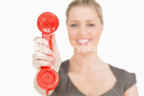 Retro red phone in a hand of woman