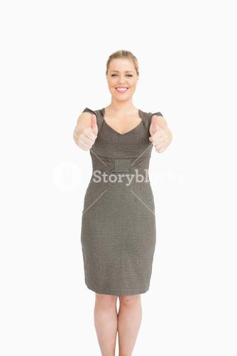 Woman standing while she is thumps up