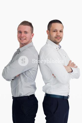 Two men standing back-to-back