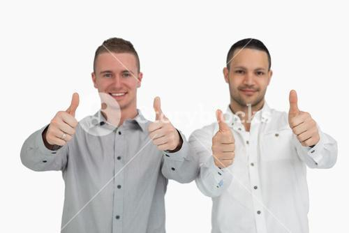 Two men putting their thumbs up
