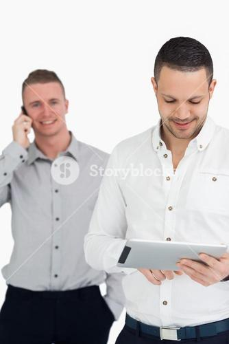 Men using phone and tablet computer