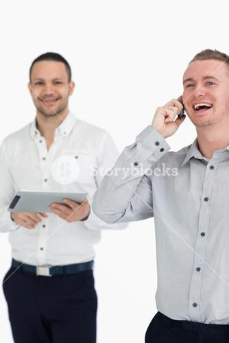 Laughing men with a phone and a tablet computer
