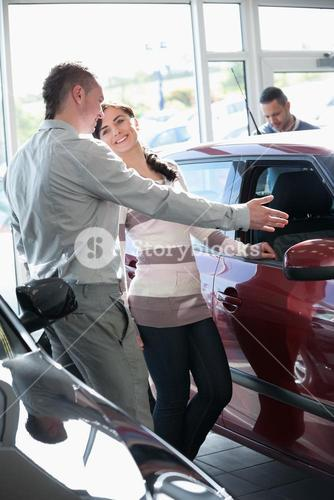 Woman talking with a salesman