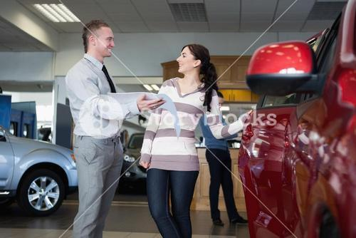 Smiling salesman talking with a woman