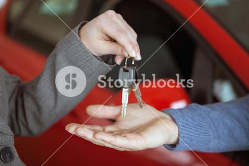 Person handing keys to someone else