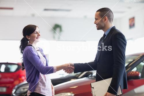 Salesman and a woman shaking hands