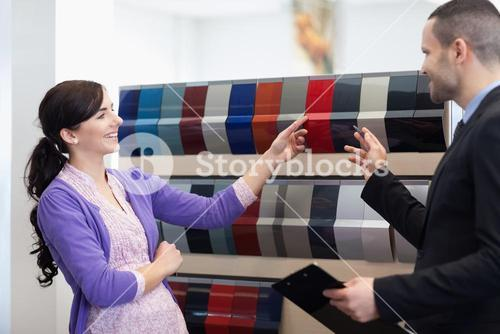 Man and woman choosing color in a color palette