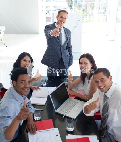 Business people in a meeting with thumbs up
