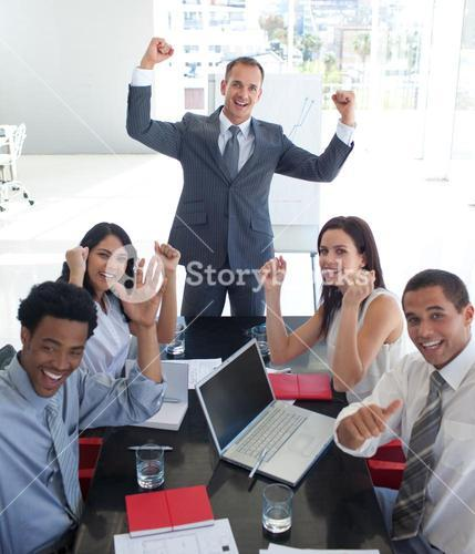 Business team in a meeting celebrating a success