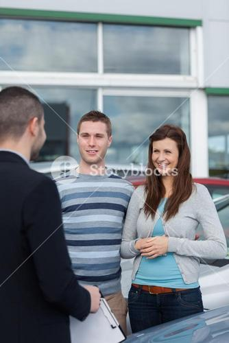 Clients talking with a dealer