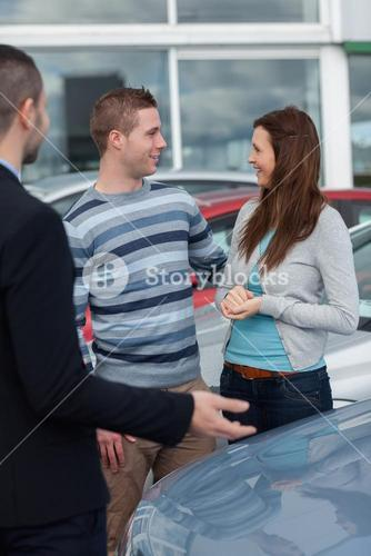 Consumers talking with a man