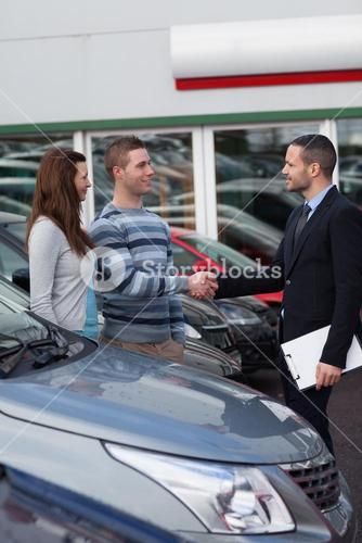 Businessman shaking hand of a man