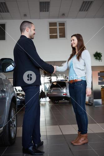 Dealer shaking hand of a woman
